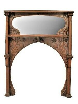 French Art Nouveau mahogany fireplace mantel with carved whiplash, lily pad & fl