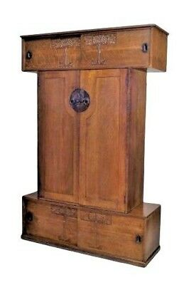 English Arts & Crafts oak armoire with a top and bottom cabinet with sliding doo