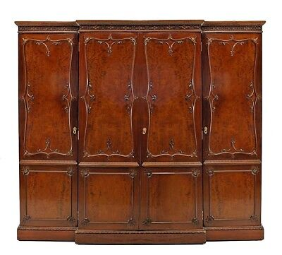 English Victorian mahogany armoire cabinet with 4 doors have a carved design fra