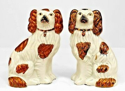 Pair of English Victorian Small Staffordshire White Dog Figures