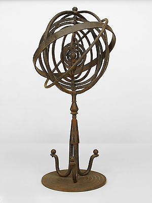 Italian Mid-Century Modern wrought iron armillary with a center sun surrounded b