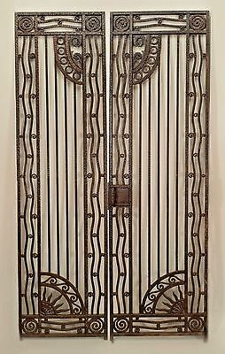 2 Pair of French Art Deco wrought iron gates with handles having a vertical grid