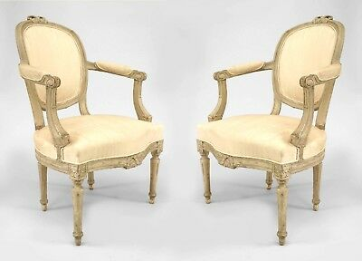 2 Pair of French Louis XVI white painted open arm chairs with oval back having a