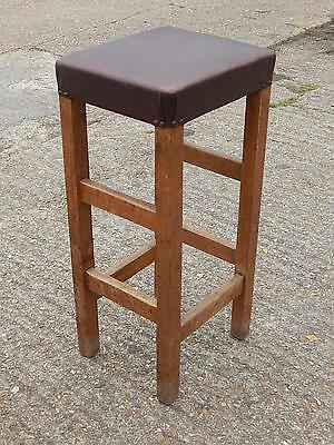 Vintage industrial chic solid oak bar stool with brown vinyl seating -architects