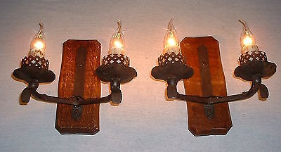 Vintage Gothic French wrought iron sconces on a wood back plate