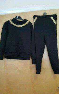 Black and gold girls lounge set tracksuit 11-12 years