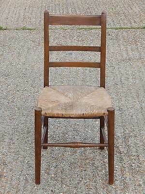 Antique oak arts & crafts style dining chair with strung seating +leg stretchers