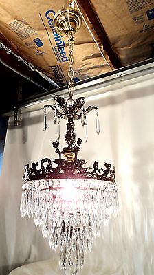Beautiful Cake style chandelier with angels in brass