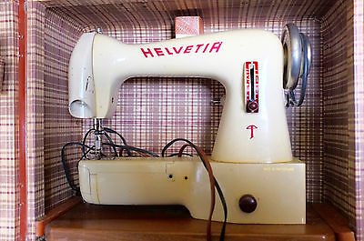 Vintage electric Helvetia sewing machine with original box of accessories/tools
