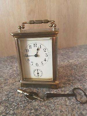 Antique French Carriage Clock with alarm and Porcelaine face