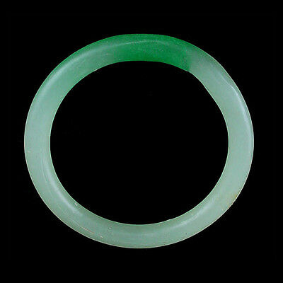 A Qing Dynasty green and white glass bracelet. Made to imitate jadeite. x9112