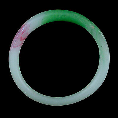 A Qing Dynasty green and white glass bracelet. Made to imitate jadeite. x9108