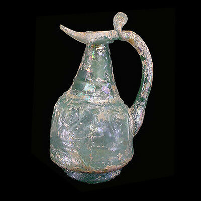 Early Islamic moulded pale green glass ewer x6309