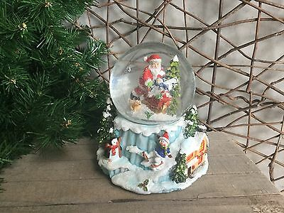 Heaven Sends large Christmas scene Santa snowman penguin snow globe 15cm