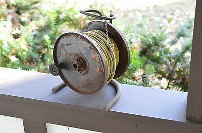 antique rope or power cord winder holder rusty farm fresh wood handle vintage