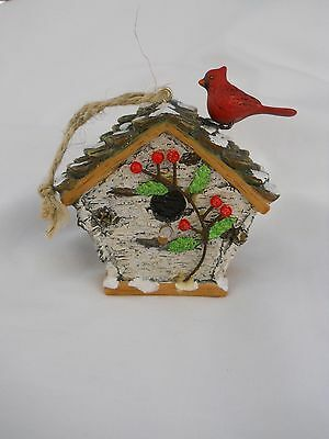Birdhouse with Cardinal Sitting on Snow-Covered Roof Christmas Ornament