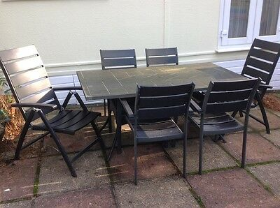 stone top aluminium garden table and 6 chairs