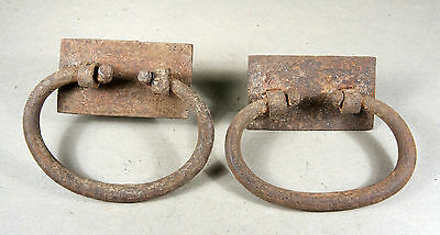A Pair of Early Rustic Wrought Iron Chest Lifts