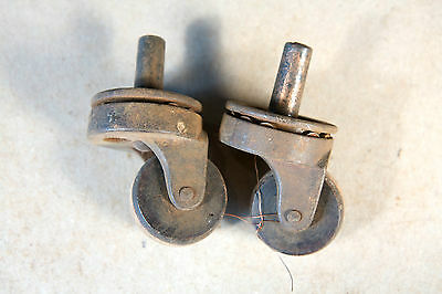 Two Vintage Cast Iron Casters with Wooden Wheels and Wheel Bearings