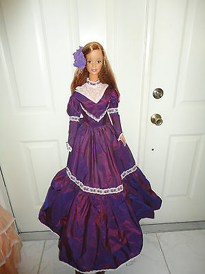 my size barbie excellant condition red hair purple taffata dress