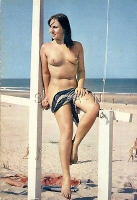 Original 1960s French Nude Pinup PC- Naturisme- Woman Sits on Flag Stand- Beach