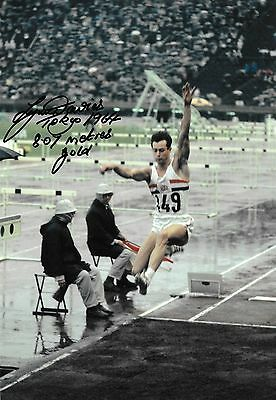 lynn davies making a successful jump in the final tokyo 1964 signed 12x8 photo