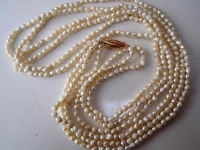 Vintage 11.5in long 3 strand seed pearl necklace with gold plate clasp