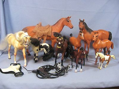 Group of 8 plastic toy Horses