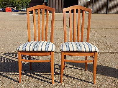 Pair of 2x solid pine stick back dining chairs with upholstered fabric seats
