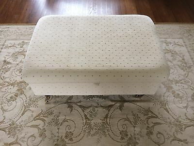 Laura Ashley Elliot footstool with dark wooden legs and gold castors