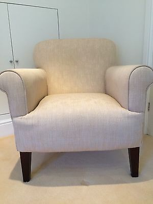 Laura Ashley armchair covered in natural fabric with dark legs