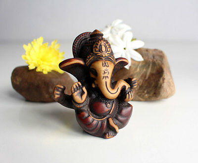 "Four Armed Baby Ganesh Resin Statue 2.5"" with Red Patina"