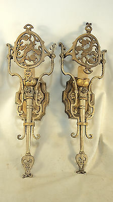 Pair of Beautiful Antique cast brass wall sconces by Lincoln