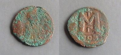 #b311# Byzantine Follis coin of Justin I from 518-527 AD