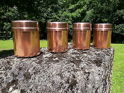 4  copper canisters storage tins jars with lids in great condition