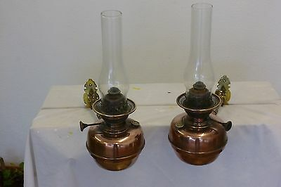 Pair of Wall mounted swivel oil lamps