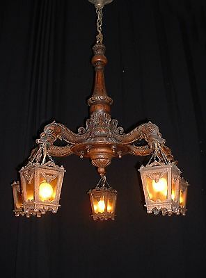 Antique French carved wood chandelier with lanterns mythological figures