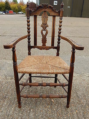 Vintage highly carved oak bobbin turned carver hall chair armchair rush seated