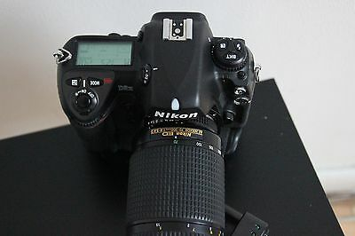 camera nikon d2h with lens 70-300 and battery and charge.