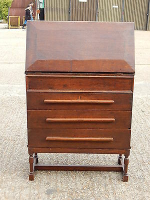 Antique solid oak bureau cabinet with pull down writing desk & three drawers