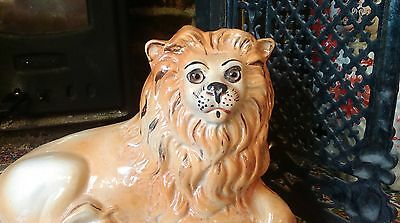 A pair of Victorian Staffordshire figure of a recumbent Lions