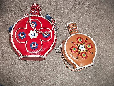 2 vintage decorative leather-covered glass bottles from Yugoslavia