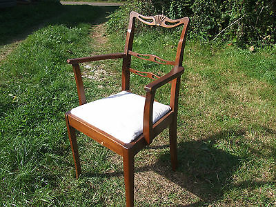 single wooden framed chair, with upholstered seat