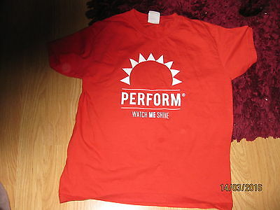Red childrens top with Perform & Watch Me Shine on it. 9/10 yrs size Either sex.