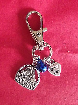 Cat Collar charm with Cat in a basket , Double sided Heart and Blue metalic bell