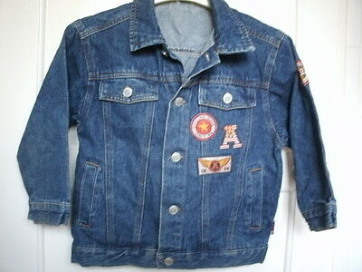 Adams. Denim blue jacket with badges on & stud like buttons. Age 6yrs.