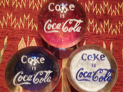 COCA COLA 1970's GLASS HEAVY PAPER WEIGHTS-- 3 DIFFERENT COLORS- RED-WHITE-BLUE