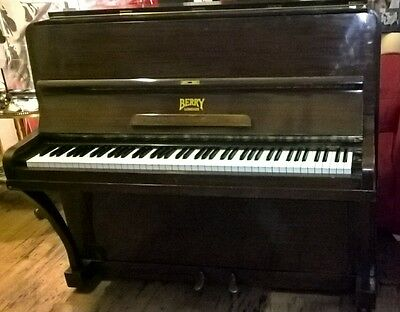 vintage berry upright piano