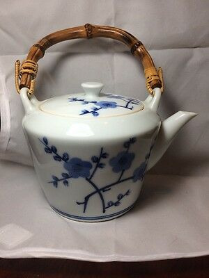 Oriental Blue And White Teapot With Wooden Handle