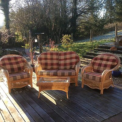 Lovely Cane conservatory furniture.